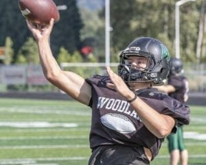 Tyler Flanagan of Woodland might be known as a running quarterback, but this guy can pass, too. He had four TD passes in a win over La Center. Photo by Mike Schultz