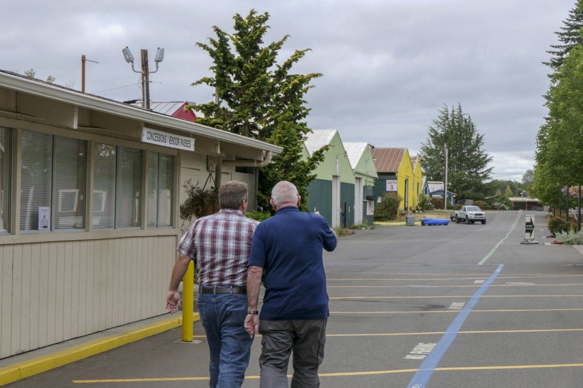 John Morrison and Mickey Webb walk the grounds at the Clark County Fair. Webb is taking over as director of the fair. Photo by Chris Brown