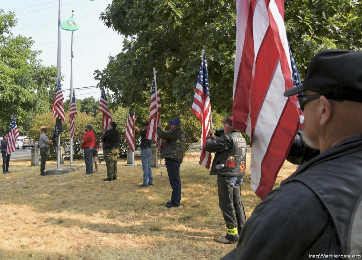 The Southwest Washington District Patriot Guard Riders, create a flag line at last weeks remembrance ceremonies by the Fort Vancouver Barracks. Photo courtesy of Q Madp