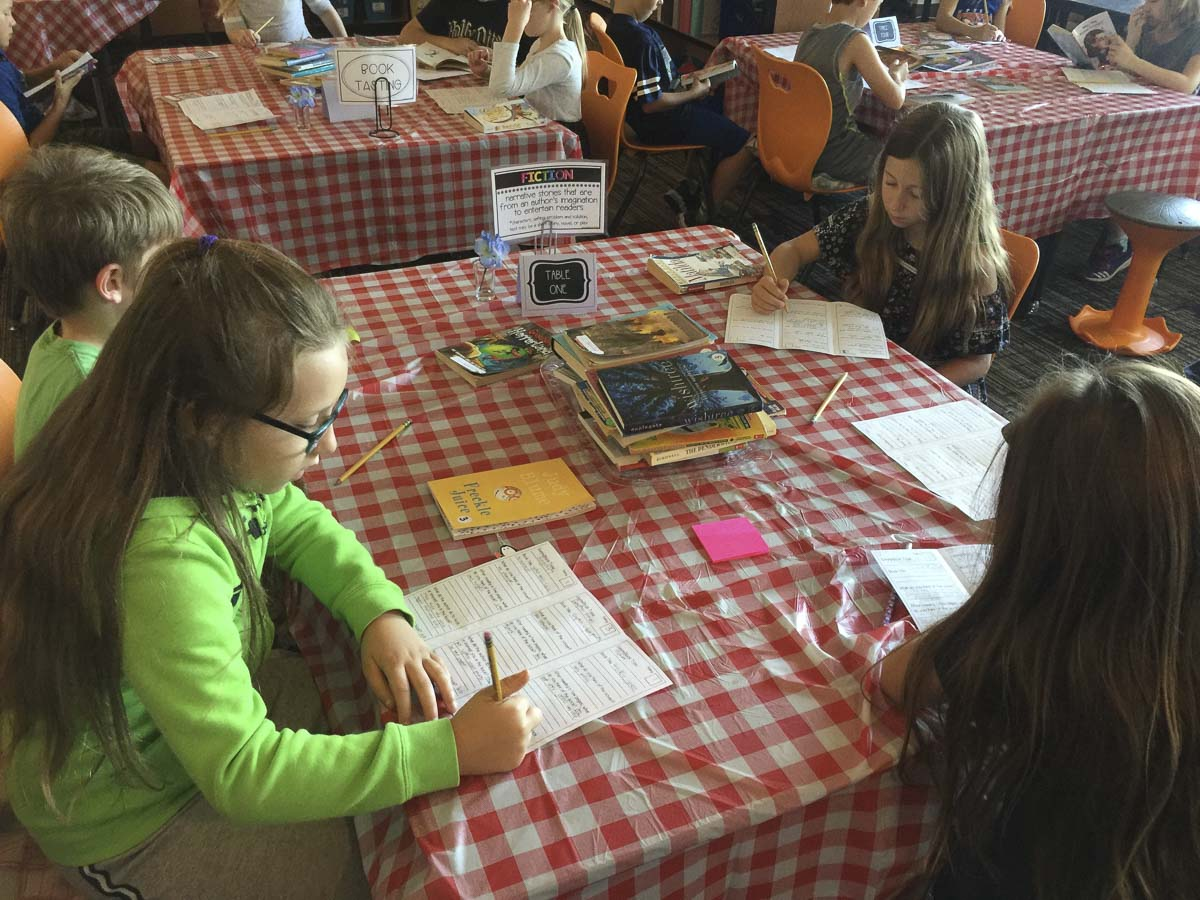 Third graders in Kari Hall's class at Union Ridge Elementary sample the books on the menu in the Book Cafe. Photo courtesy of Ridgefield School District