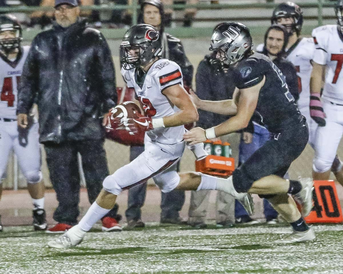 Camas running back Shane Jamison (12) looks for yardage Friday at McKenzie Stadium. Jamison scored the Papermakers' only touchdown in a 14-7 loss to Union. Photo by Mike Schultz