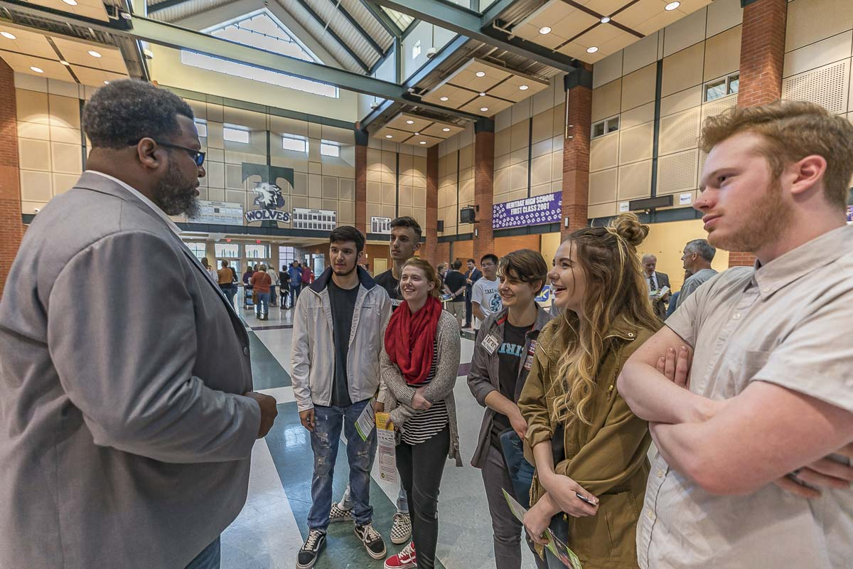 Candidate for the second position in the 17th Legislative District, Damion Jiles (D), talks with students during a meet-and-greet session prior to the forum. Photo by Mike Schultz