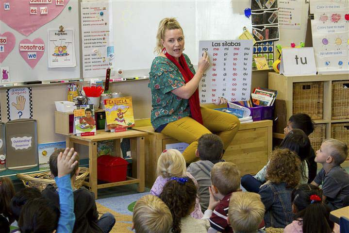 Jill Thoeny, one of two bilingual kindergarten teachers at Woodland Primary School, teaches half of each school day in Spanish and the other half in English. Photo courtesy of Woodland School District