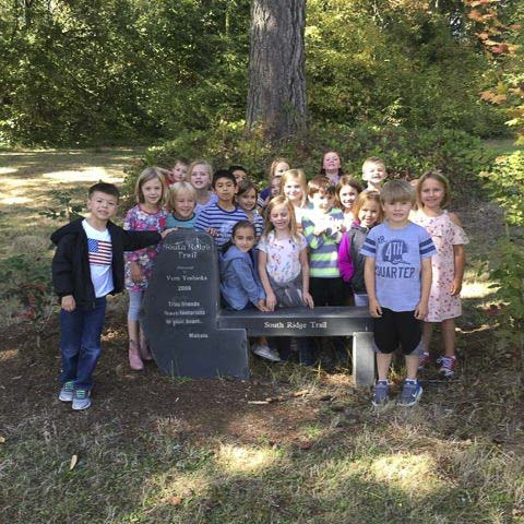 First graders in Margo Manke's class at South Ridge Elementary School are on the trail at the school's outdoor learning space. Photo courtesy of Ridgefield School District
