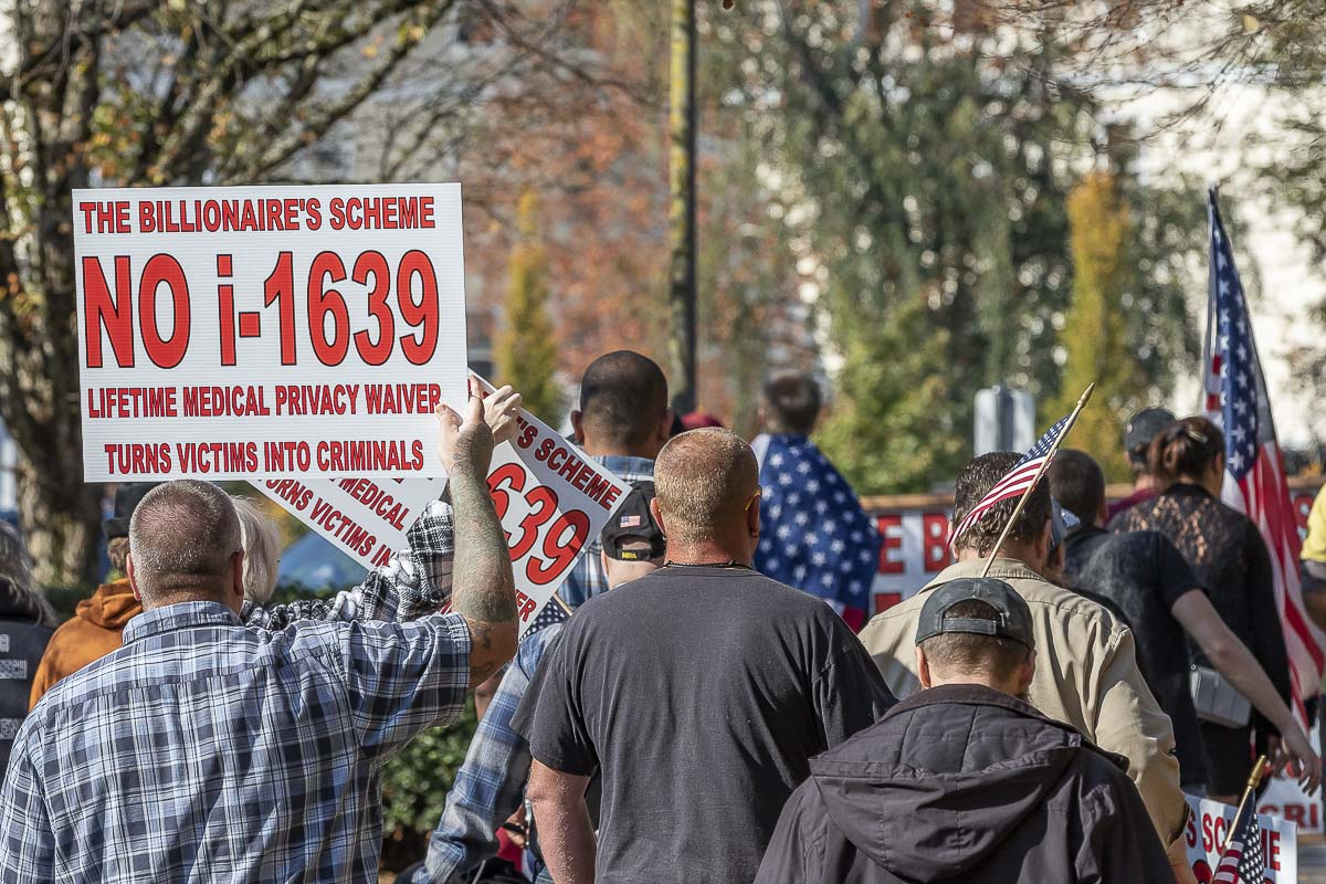 Members of Patriot Prayer walk from Clark College to the Evergreen Boulevard overpass in Vancouver during a rally opposing I-1639 on Oct. 22. Photo by Mike Schultz