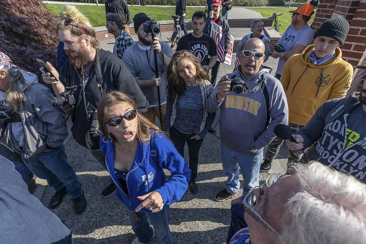Members of Patriot Prayer debate with new arrivals to their rally at Clark College. Photo by Mike Schultz