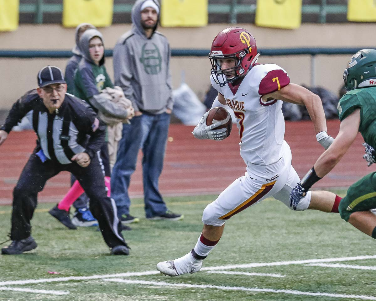 Prairie wide receiver Nolan Mickenham (7) attempts to stay inbounds while he eludes an Evergreen defender in Friday's game at McKenzie Stadium. Photo by Mike Schultz