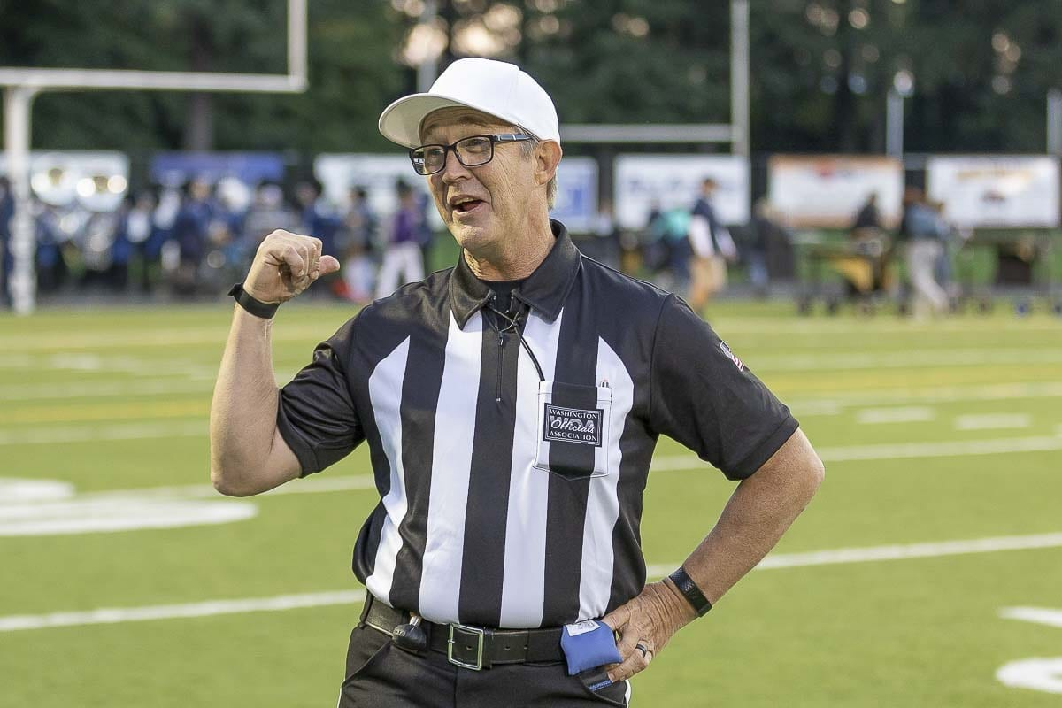 Jim Goss is a member of the Washington Officials Association as well as the Evergreen Football Officials Association. Membership is down at the Clark County organization. Veteran officials such as Goss are hoping to attract new officials to the game. Photo by Mike Schultz