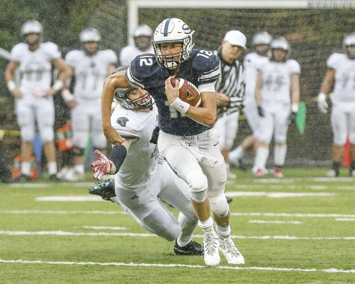 Skyview quarterback Yaroslav Duvalko (12) breaks free from a lunging Union defender during Friday's game at Kiggins Bowl. Photo by Mike Schultz