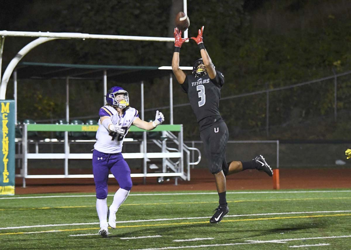 Darien Chase goes up to catch this pass against Puyallup on Friday at McKenzie Stadium. He caught nine passes for 91 yards and a touchdown in Union's 38-31 win. Photo by Kris Cavin