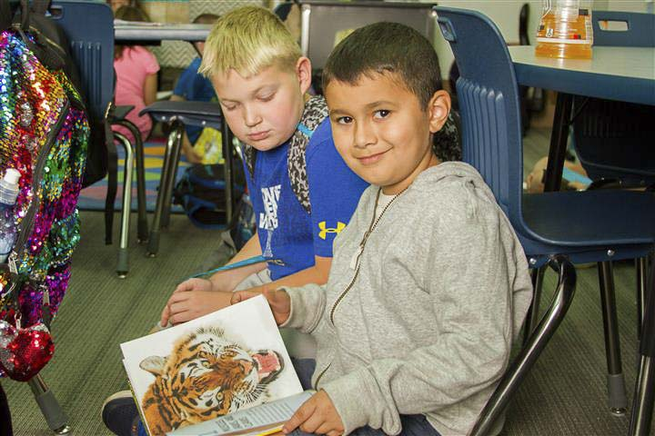 Fourth graders at Woodland Intermediate School are assigned second-grade Book Buddies to help each other develop better reading skills. Photo courtesy of Woodland School District