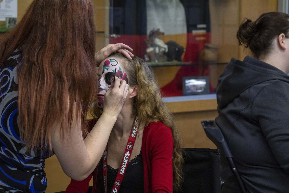 Students get their faces painted in spooky ways at Clark College on Halloween as part of the Halloween On-Campus. Photo by Jacob Granneman