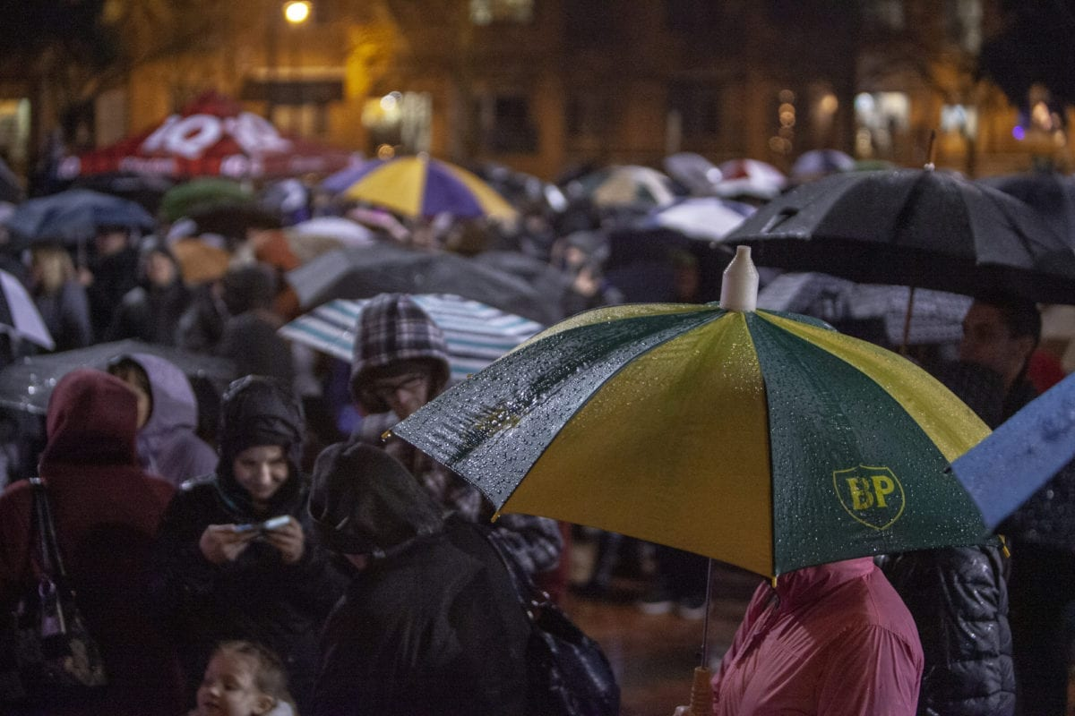 Despite frequent bouts of heavy rain, hundreds of people remained at the Vancouver tree lighting in Esther Short Park on Black Friday. Photo by Jacob Granneman