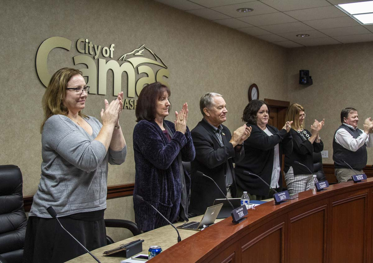 Members of the Camas City Council applaud the people who rescued two men after a boating accident in September. Photo by Jacob Granneman