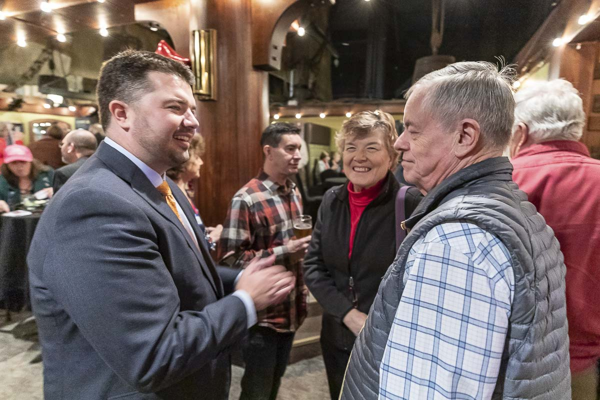 State Rep. Brandon Vick (left) takes time to visit with area residents Janet and Don Scott at a gathering at Warehouse 23 in Vancouver Tuesday night. Vick leads Chris Thobaben in the race for position 1 in the 18th Legislative District. Photo by Mike Schultz
