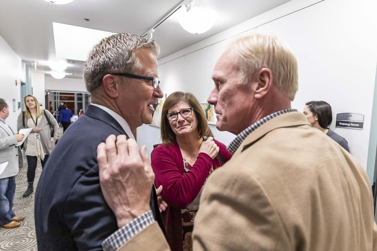 Larry Hoff (left) and Paul Harris take a moment Tuesday night to share their reactions to the initial results from the Nov. 6 general election. Hoff leads Kathy Gillespie in the race for position 2 in the 18th Legislative District and Harris leads challenger Damion E. Giles, Sr. in the race for position 2 in the 17th Legislative District. Photo by Mike Schultz