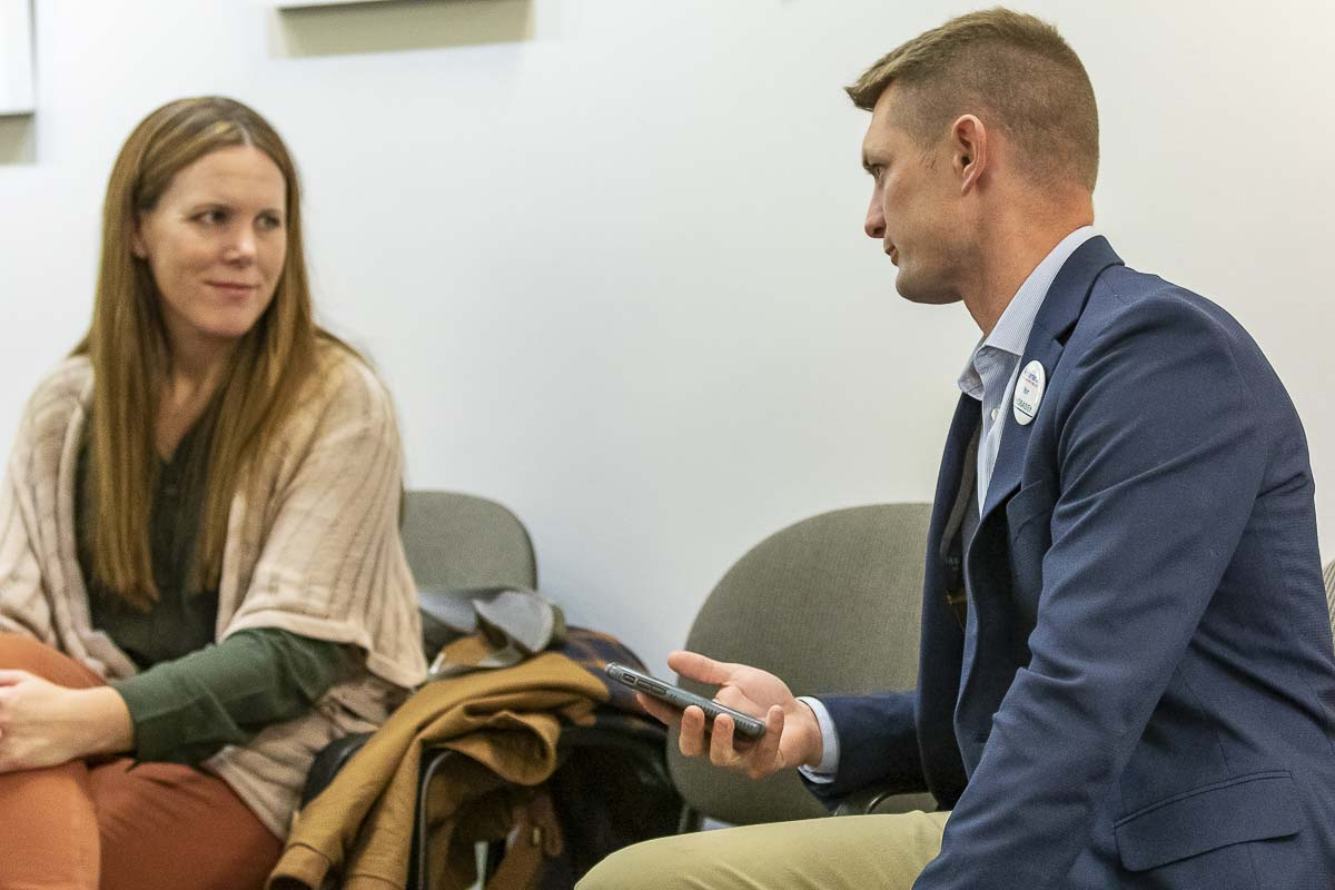 18th District Legislative candidate Chris Thobaben (right) talks with Vancouver City Council candidate Sarah Fox on election night at the Clark County building. Photo by Mike Schultz