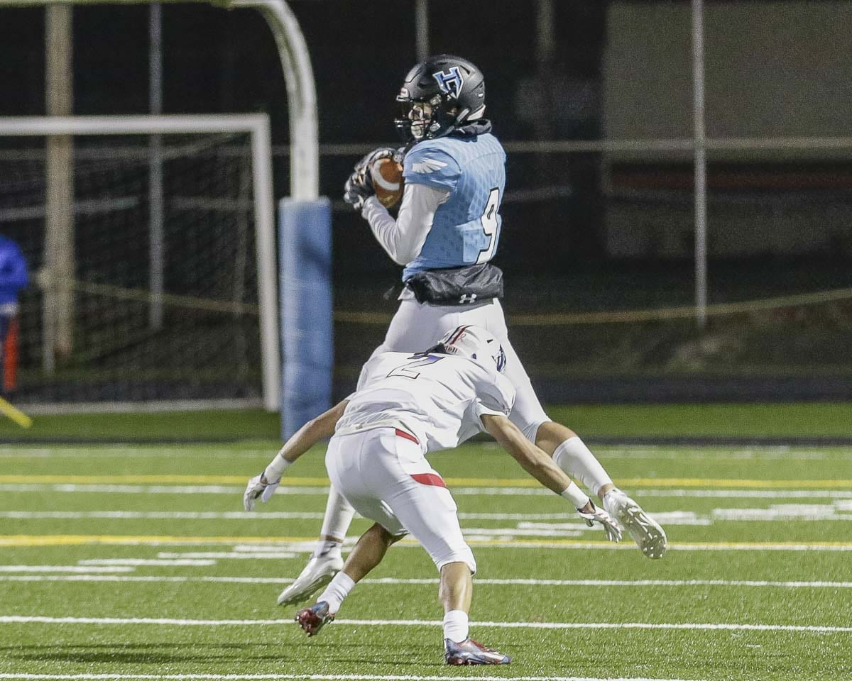 Hockinson receiver Peyton Brammer (9) makes a catch during Friday's Class 2A state high school football playoff game at District Stadium in Battle Ground. The Hawks won to remain undefeated and advance to the quarterfinals next week. Photo by Mike Schultz