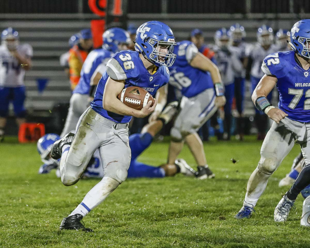 La Center running back Wyatt Dodson (36) rushes around the end during the Wildcats' 33-21 loss to Elma Friday at La Center High School. Dodson scored two touchdowns for the Wildcats in the loss. Photo by Mike Schultz