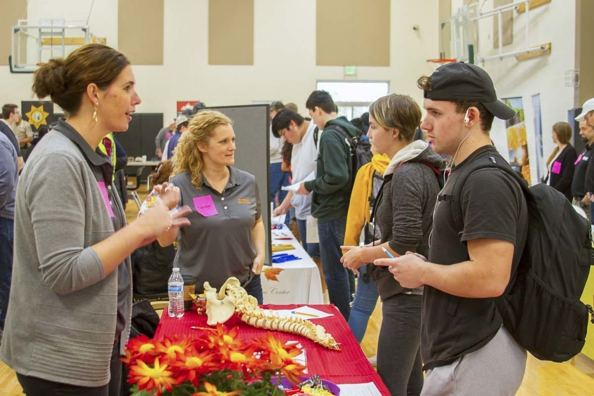 More than 40 local businesses attended Woodland Days to speak with students like Spenser Best (pictured here, right). Photo courtesy of Woodland Public Schools