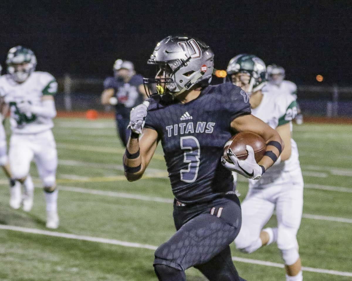 Union receiver Darien Chase (3) races upfield during the Titans' 50-10 victory over Skyline Friday at McKenzie Stadium. Photo by Mike Schultz