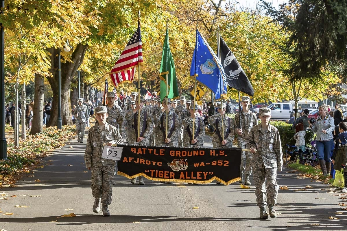 Members of the Battle Ground High School Air Force JROTC participate in the annual Veterans Day Parade Saturday at Fort Vancouver. Photo by Mike Schultz