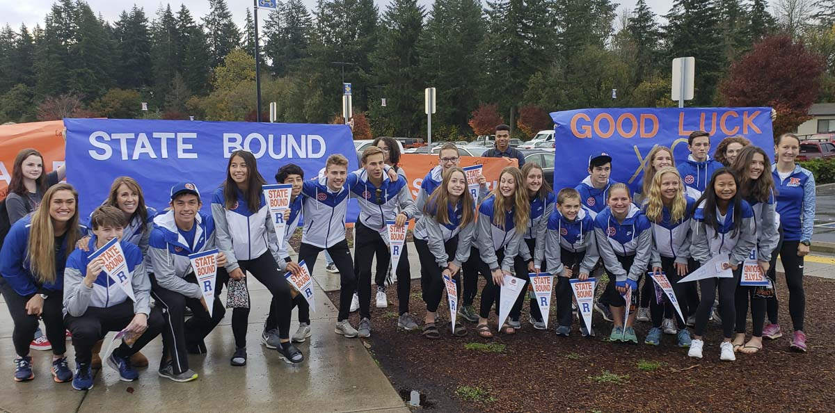 Both the Ridgefield boys and girls cross country teams qualified for state. The school gave them a send-off Friday morning, along with a police escort out of town. The state meet is Saturday in Pasco. Photo by Paul Valencia