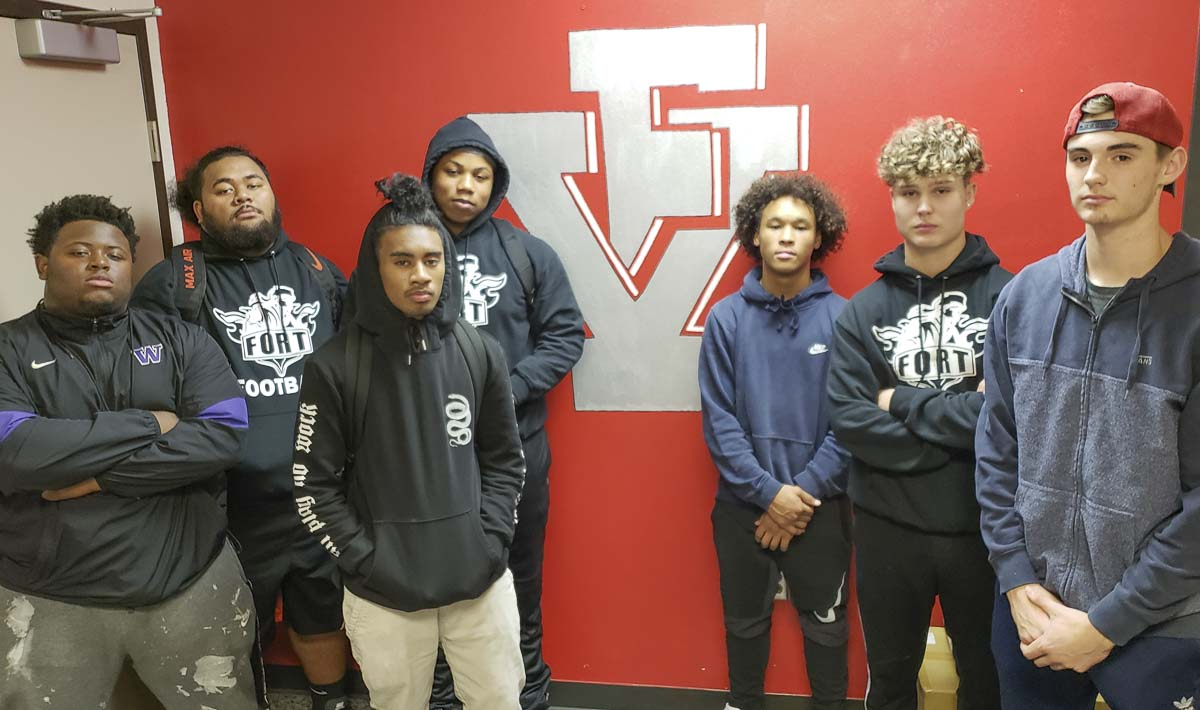 Seniors Myron Lawrence, Jonavin Salavea, McWayne Ridep, Zijeon Lawrence, Anthony Wilhite, Tyler Runkle, and Nick Laurenza are proud of the commitment they made to Fort Vancouver football. They (and Tana Heather) provided leadership, making for a positive experience during a tough season. Photo by Paul Valencia