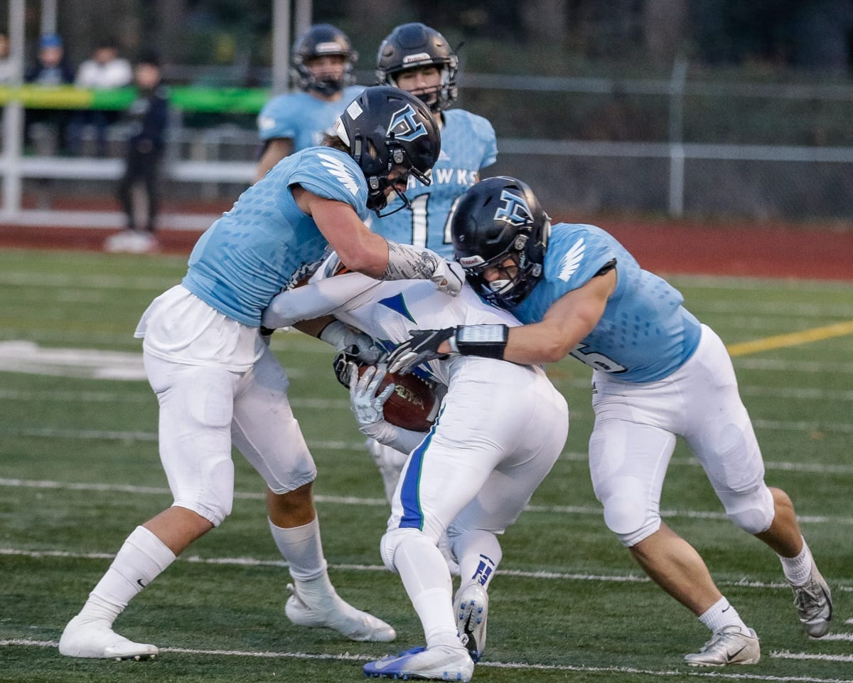 Hockinson defenders Sawyer Racanelli (11) and Nick Frichti (6) stop a Liberty runner during Saturday's semifinal win at McKenzie Stadium. The Hawks' defense shutout Liberty in the second half. Photo by Mike Schultz