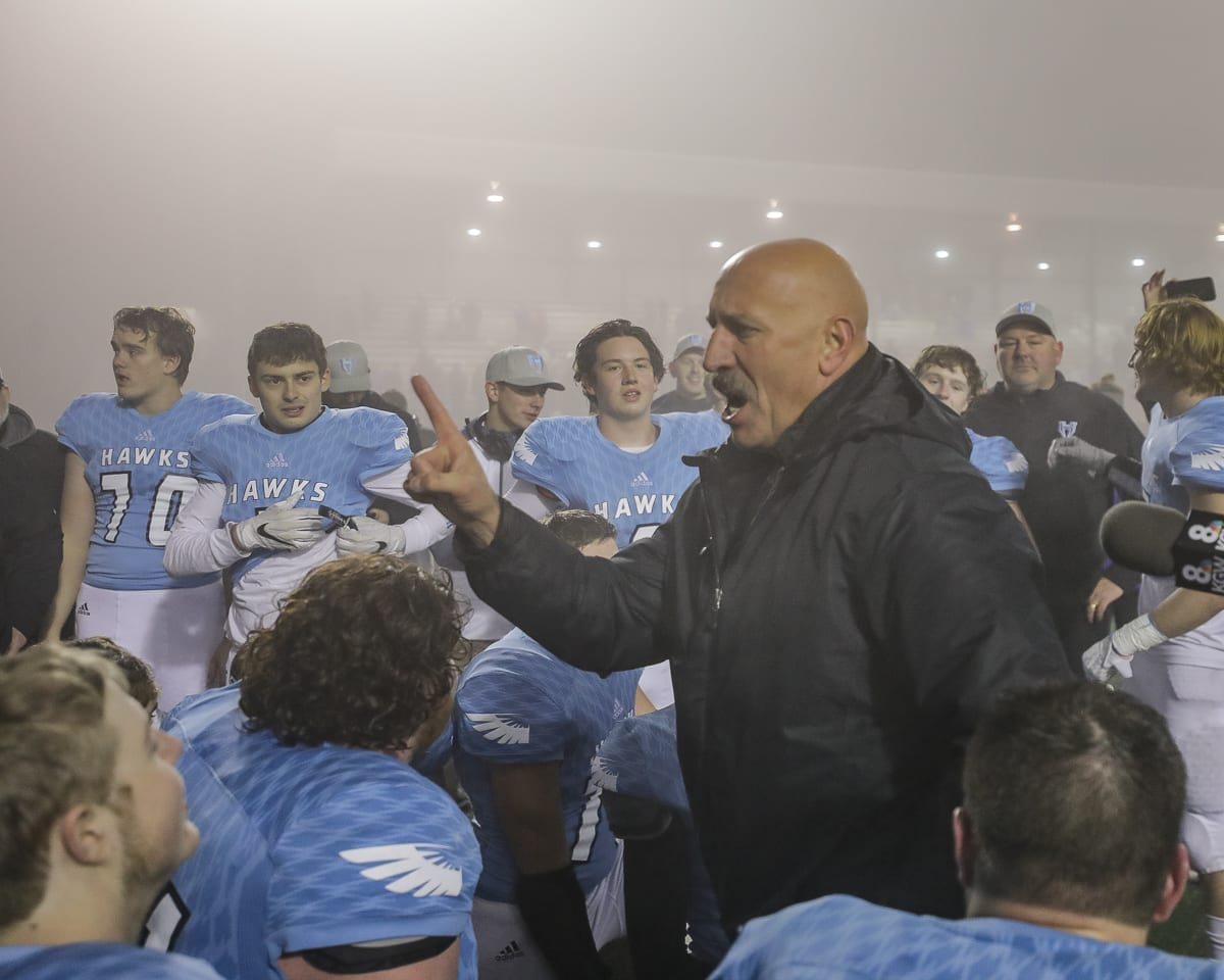 An emotional Hockinson coach Rick Steele addresses his team after Saturday's 27-24 win over Liberty in the Class 2A state high school semifinals at McKenzie Stadium. Photo by Mike Schultz