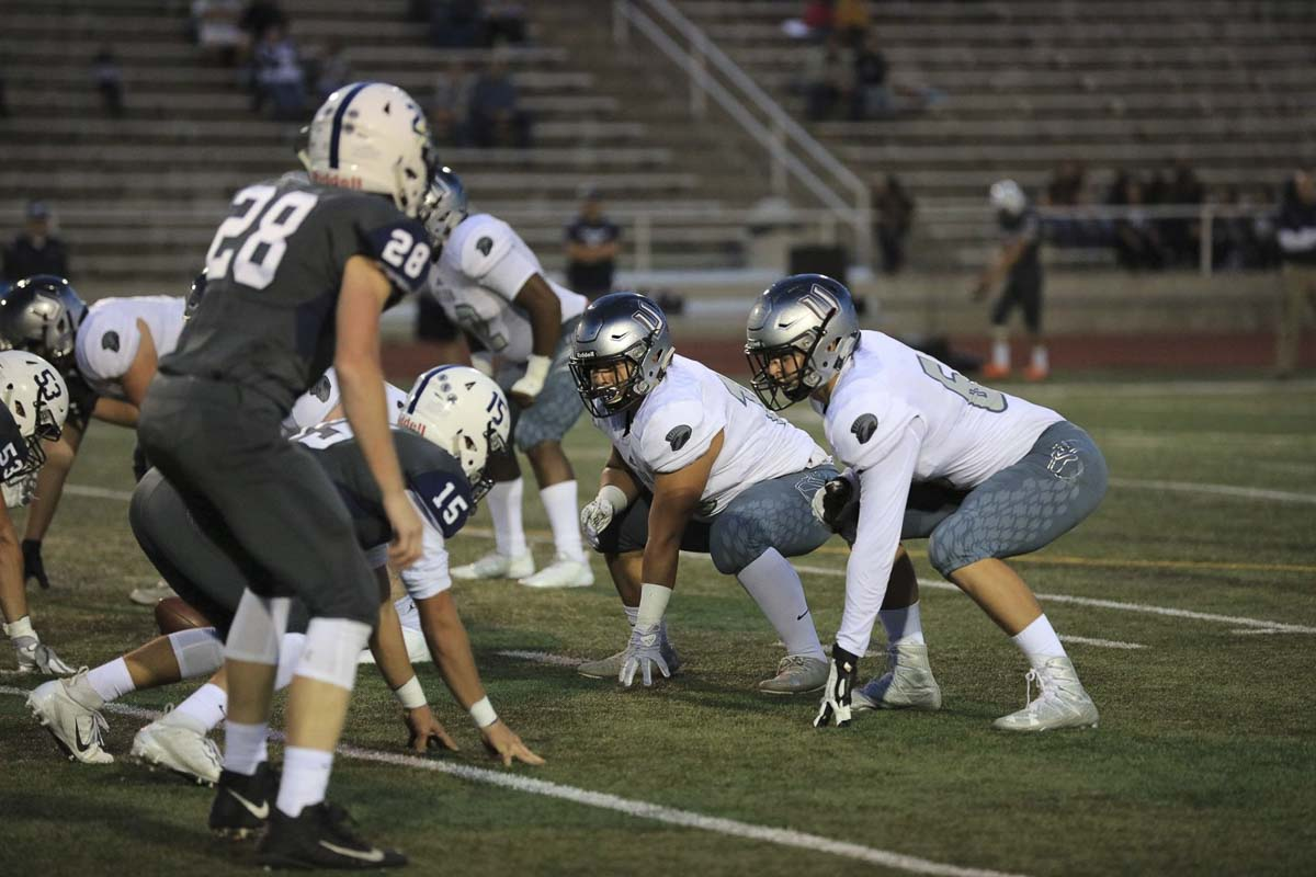 The left side of the line, Dumitru Salagor at tackle and Giovanny Rojo at guard, have been mainstays for the Titans this season. The linemen have provided the protection for the top-ranked team in Class 4A football. Photo courtesy of Heather Tianen