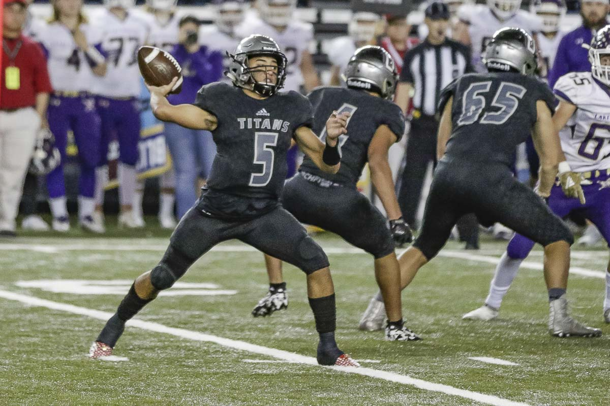 Union quarterback Lincoln Victor (5) led the Titans to a victory in the Class 4A state high school football championship game Saturday. A decade ago, he was in the dome as his brother Kapono Victor's Union team lost in the title game. Photo by Mike Schultz