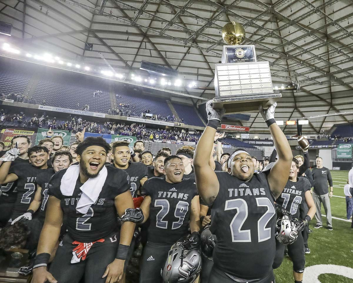 Members of the Union Titans celebrate Saturday after winning the Class 4A state high school football championship. Photo by Mike Schultz