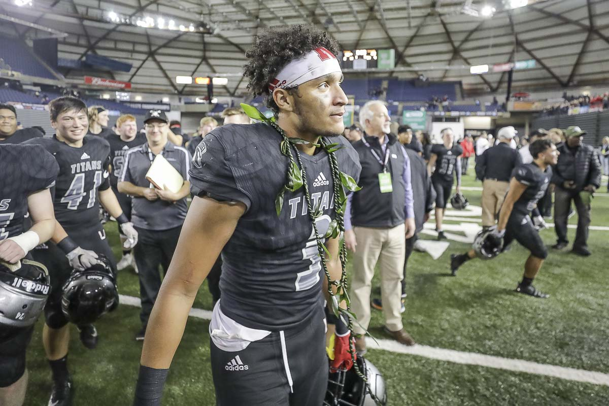 Union receiver Darien Chase (3) fought through the pain from an injury suffered in last week's semifinals to help the Titans claim the Class 4A state high school football championship Saturday at the Tacoma Dome. Photo by Mike Schultz