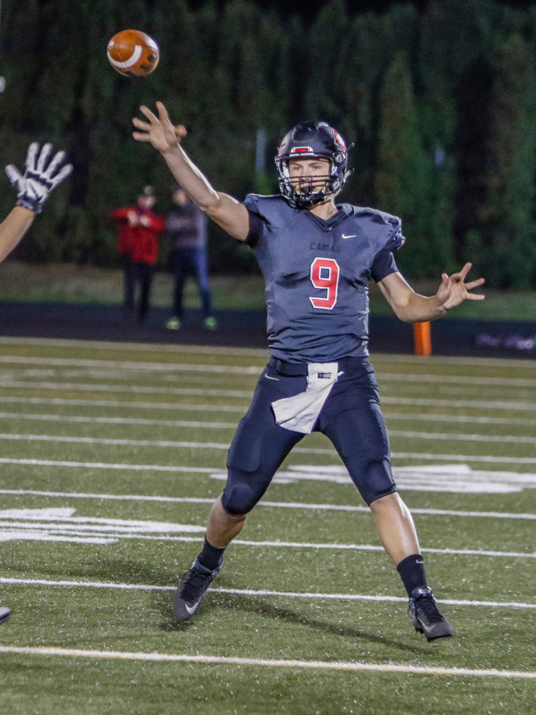 Camas quarterback Jack Colletto (9) throwing a pass in a win over Battle Ground. Photo by Mike Schultz.