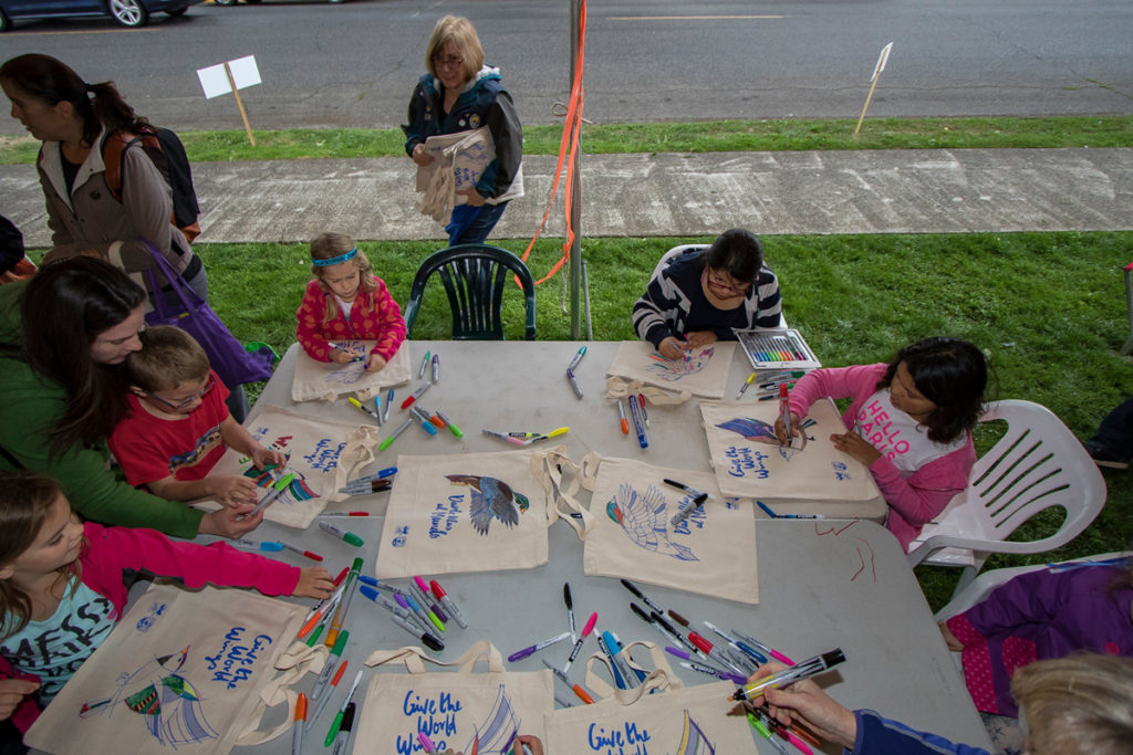 Children coloring tote bags at Davis park in downtown Ridgefield during the Bird Fest. Photo by Mike Schultz.