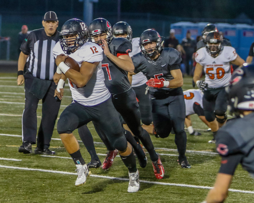 Battle Ground running back Curtis Stradley (12) scored a first quarter touchdown on this run. Photo by Mike Schultz.