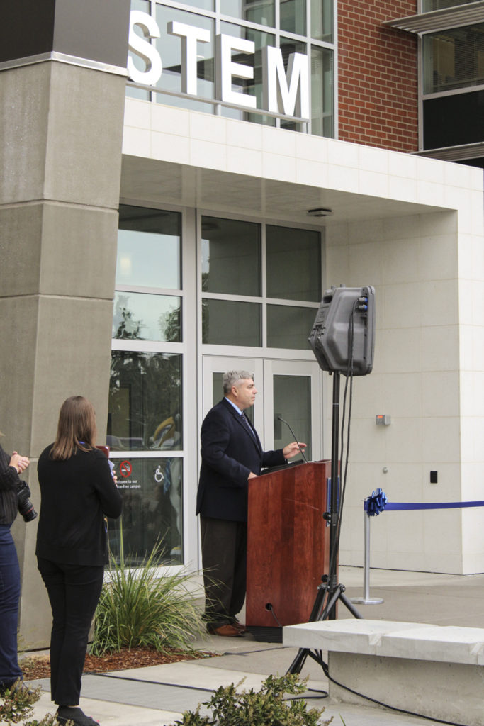 Clark College President Bob Knight speaks at the official Oct. 3 opening of his school's STEM building, which will train students for careers in science, technology, engineering and mathematics fields. The building, which is the largest instructional facility on Clark College's main campus, has been open to students since mid-September, but the official ribbon-cutting ceremony took place this week. Photo by Kelly Moyer.