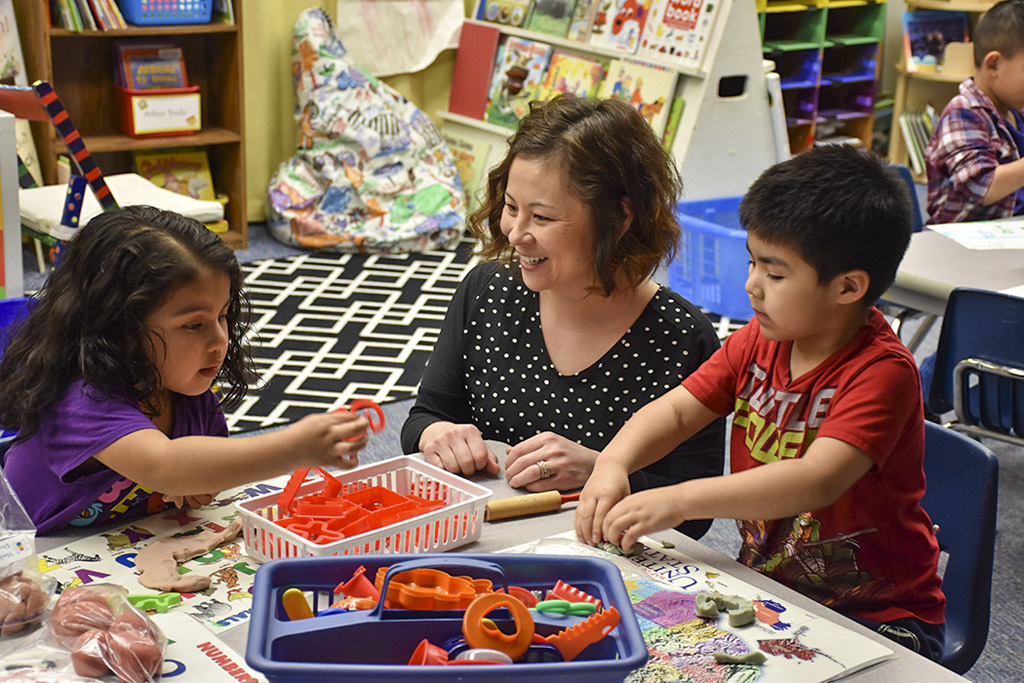 Vancouver Public Schools preschool teacher Kendra Yamamoto, pictured here with a few of her students, is the region's 'Teacher of the Year,' and was one of nine finalists for the Washington State Teacher of the Year award. Photo courtesy of Educational SD 112