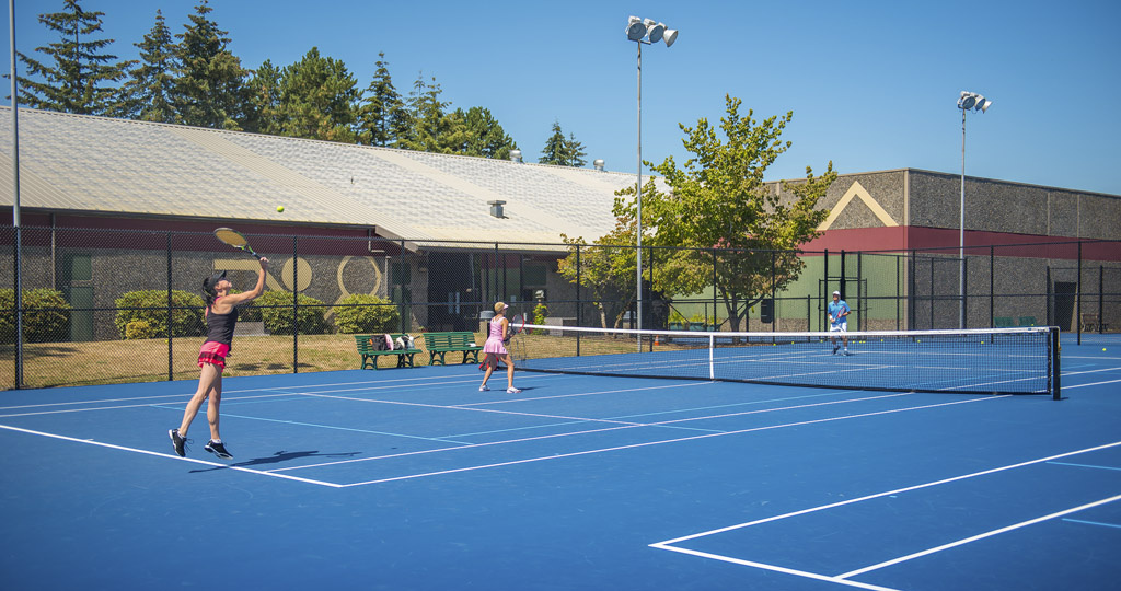 "Earlier this summer, the city of Vancouver completed a rebuild of the original courts at the Vancouver Tennis Center. Players are shown here on the improved ""Wimbledon blue'' outdoor courts. Photo courtesy of city of Vancouver"