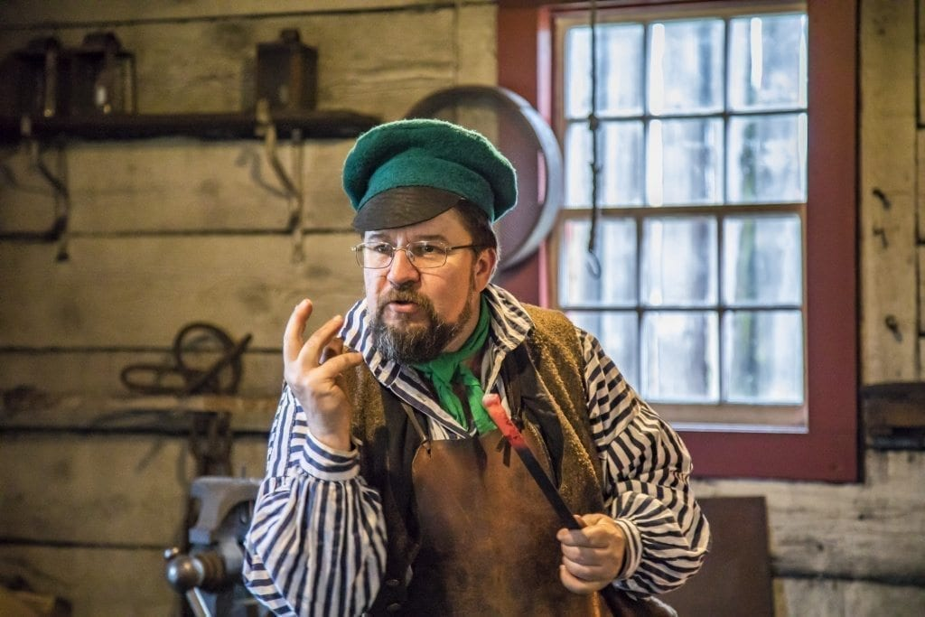 Blacksmith Wade Seiders demonstrates at the annual 'Christmas at Fort Vancouver' event Saturday at the Fort Vancouver National Historic site. Photo by Mike Schultz
