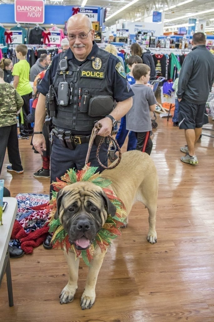Woodland Police Department Sergeant Brad Gillespie is one of the key organizers of the annual Shop With a Cop event, held Saturday at the Woodland Walmart. Gillespie is shown here with Sherman the therapy dog. Photo by Mike Schultz