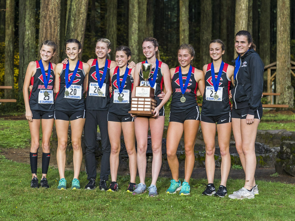 The Camas Papermakers won their fifth straight Greater St. Helens League Class 4A girls cross country title Thursday and will continue in their quest to claim their fifth state title in the past six years. Photo by Mike Schultz