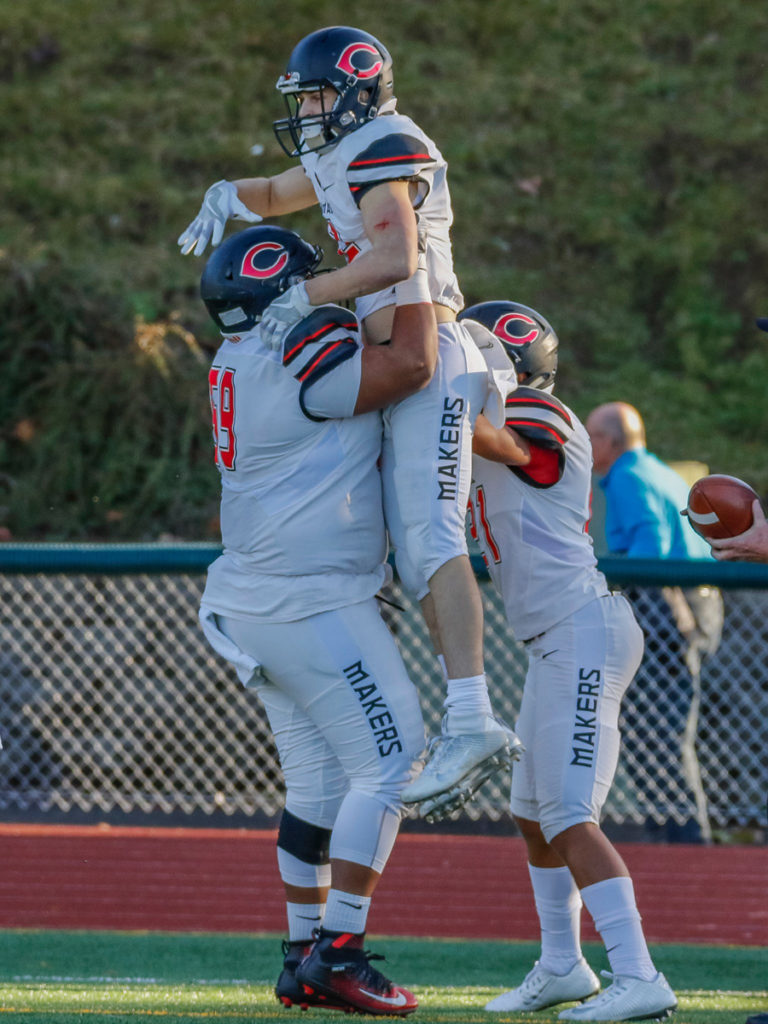 Camas offensive lineman Marcus Gray (59) celebrates a touchdown by wide receiver Ryan Rushall (2)