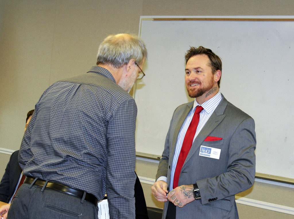 Eric Holt (right), a progressive candidate running for a state senate seat in Legislative District 18, greets Neighborhood Associations Council of Clark County Chairman Paul Ballou at the NACCC's bipartisan candidates forum held Wed., Oct. 12 in Camas. Photo by Kelly Moyer