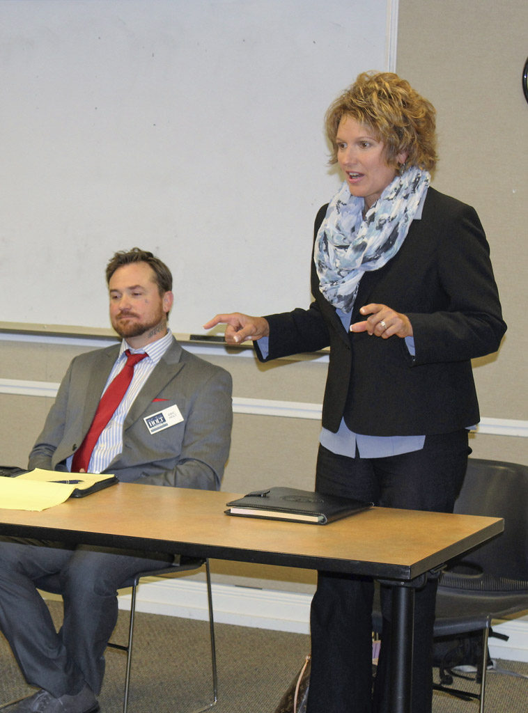 Rep. Liz Pike (right), a Republican incumbent from Legislative District 18, which represents residents in six of Clark County's seven cities as well as several areas of unincorporated Clark County, speaks at a bipartisan candidates forum, held Wed., Oct. 12 at the Camas Library, while candidate Eric Holt (left) looks on. Photo by Kelly Moyer