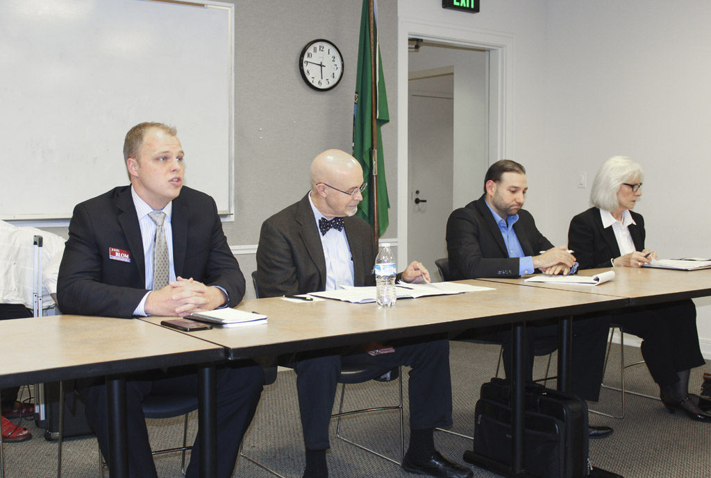 Candidates John Blom, Jim Moeller, Roman Battan and Eileen Quiring participated in a candidate forum Wednesday evening, held at the Camas Library and hosted by the Neighborhood Association Council of Clark County. Photo by Joanna Yorke