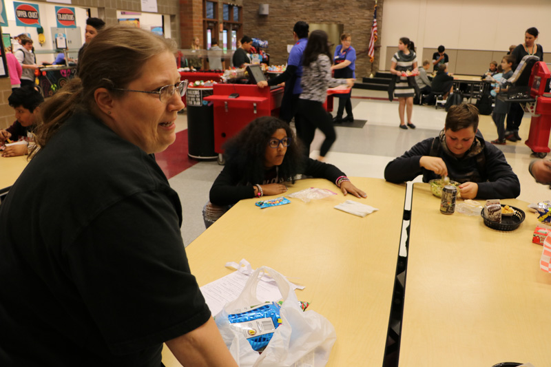 Lisa Swan, custodian at Chief Umtuch Middle School, quizzes students at the school during lunchtime. Photo courtesy of Battle Ground Public Schools