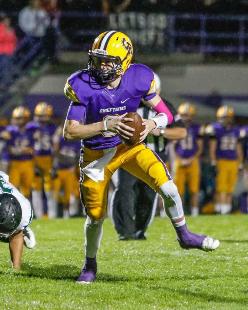 Columbia River wide receiver Jack Armstrong (9) scampers for a big gain against Woodland in the first quarter Friday at Columbia River High School. Photo by Mike Schultz.