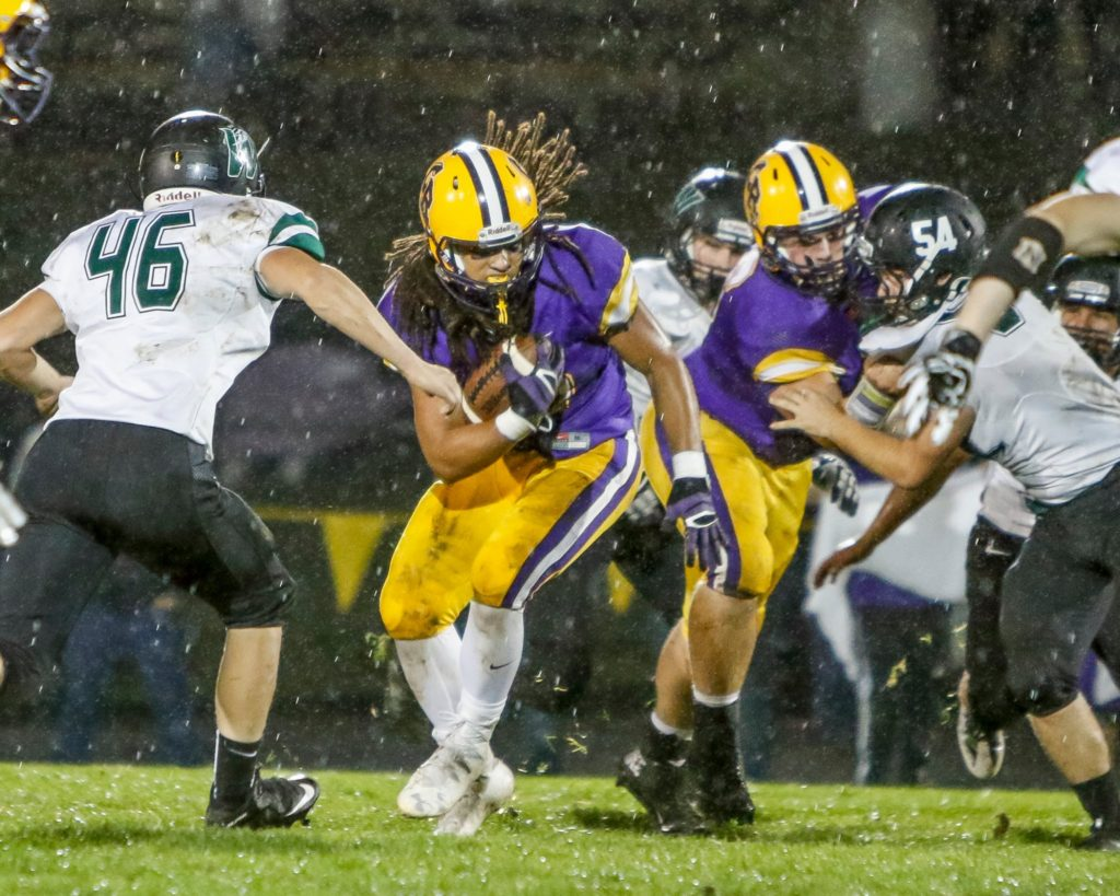 Columbia River running back Hunter Pearson (30) looks for yardage against Woodland Friday. Photo by Mike Schultz.